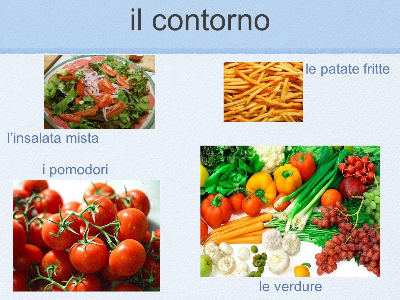 il contorno le patate fritte l'insalata mista i pomodori le verdure