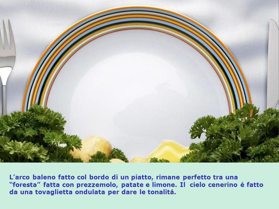L'arco baleno fatto col bordo di un piatto, rimane perfetto tra una foresta fatta con prezzemolo, patate e limone.
