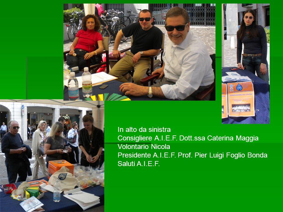 In alto da sinistra Consigliere A.I.E.F. Dott.ssa Caterina Maggia. Volontario Nicola. Presidente A.I.E.F. Prof. Pier Luigi Foglio Bonda.