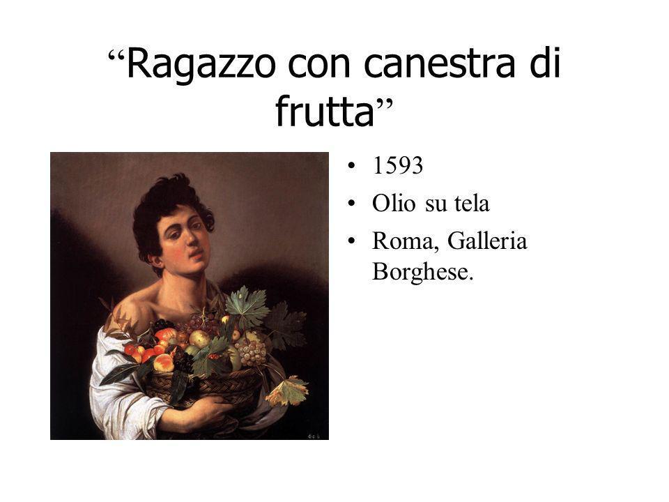 Ragazzo con canestra di frutta