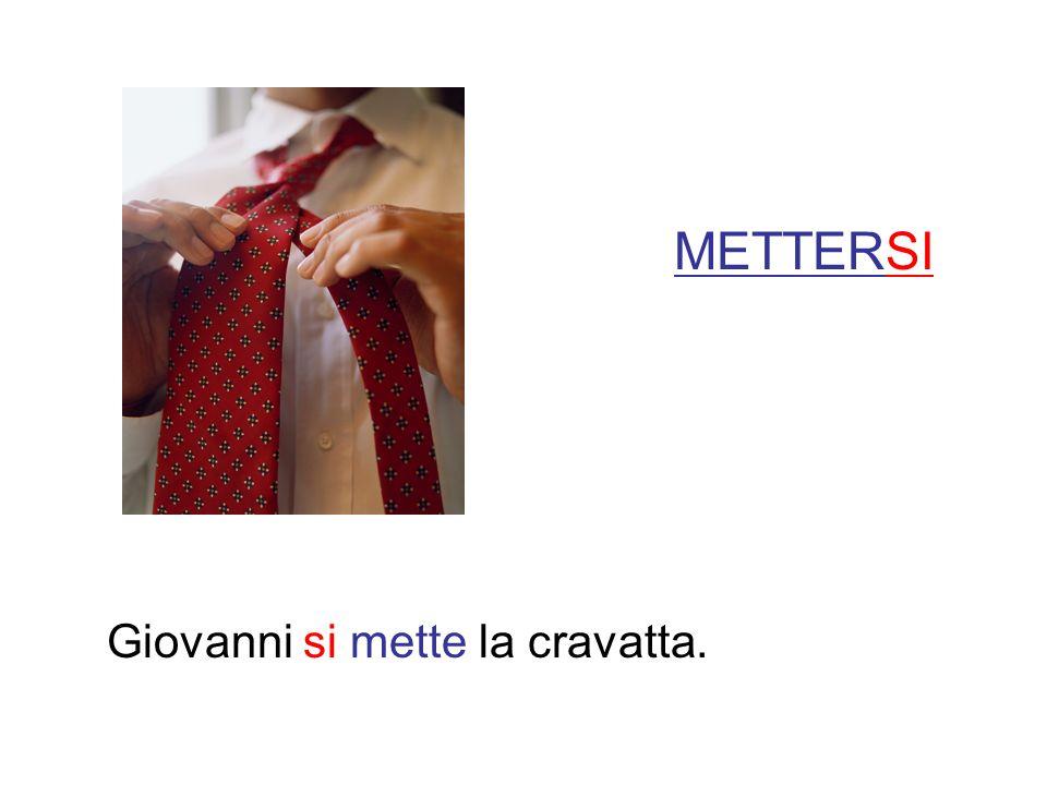 METTERSI Giovanni si mette la cravatta.
