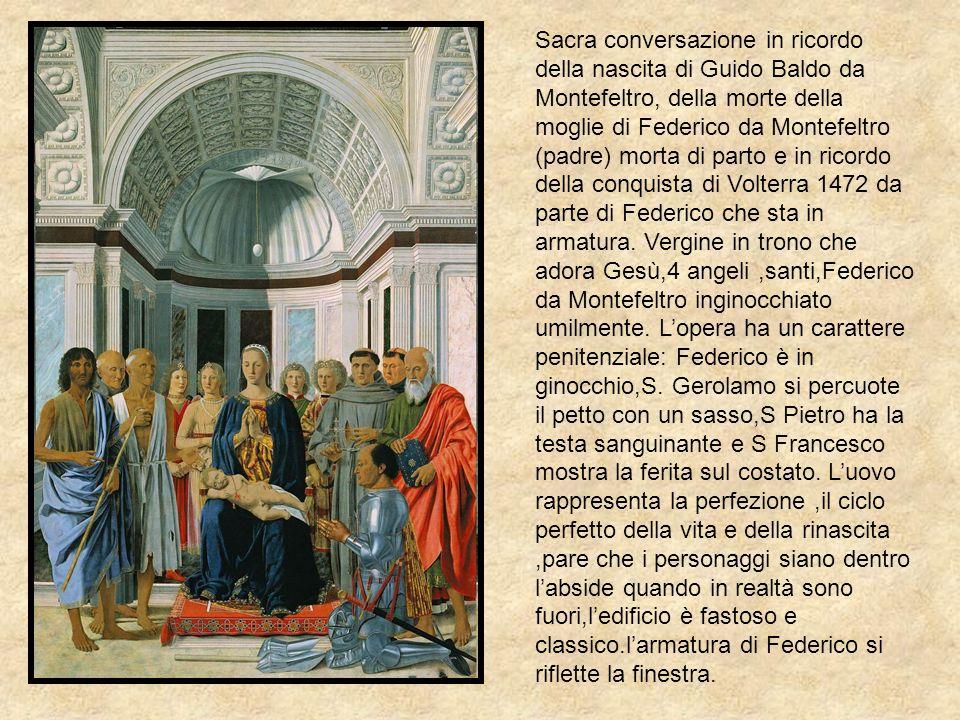 Sacra conversazione in ricordo della nascita di Guido Baldo da Montefeltro, della morte della moglie di Federico da Montefeltro (padre) morta di parto e in ricordo della conquista di Volterra 1472 da parte di Federico che sta in armatura.