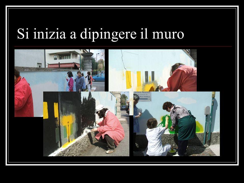 Si inizia a dipingere il muro
