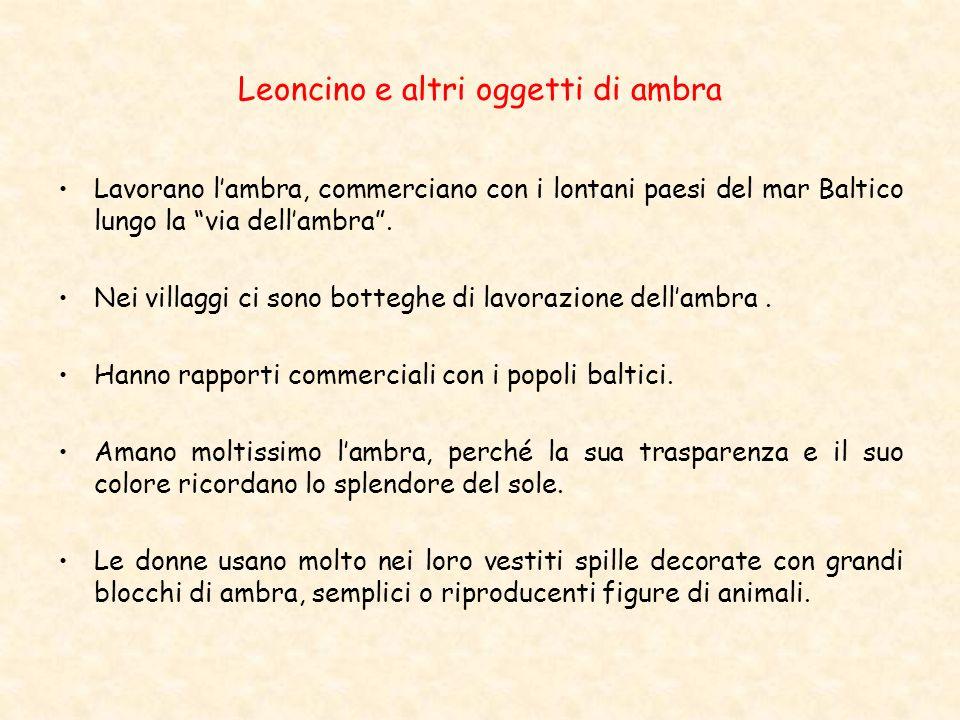 Leoncino e altri oggetti di ambra