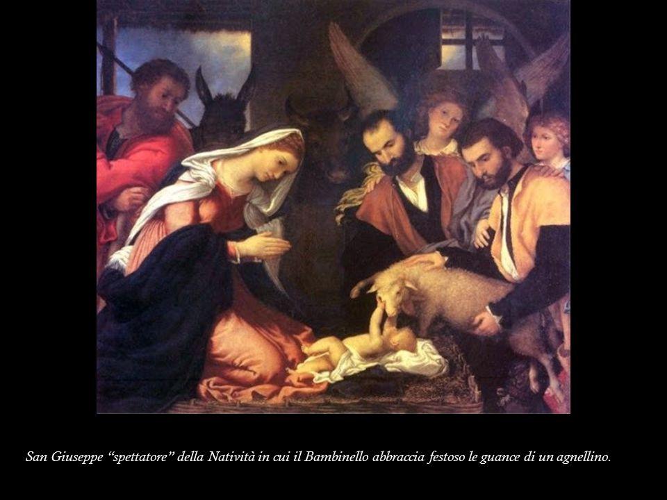 San Giuseppe spettatore della Natività in cui il Bambinello abbraccia festoso le guance di un agnellino.