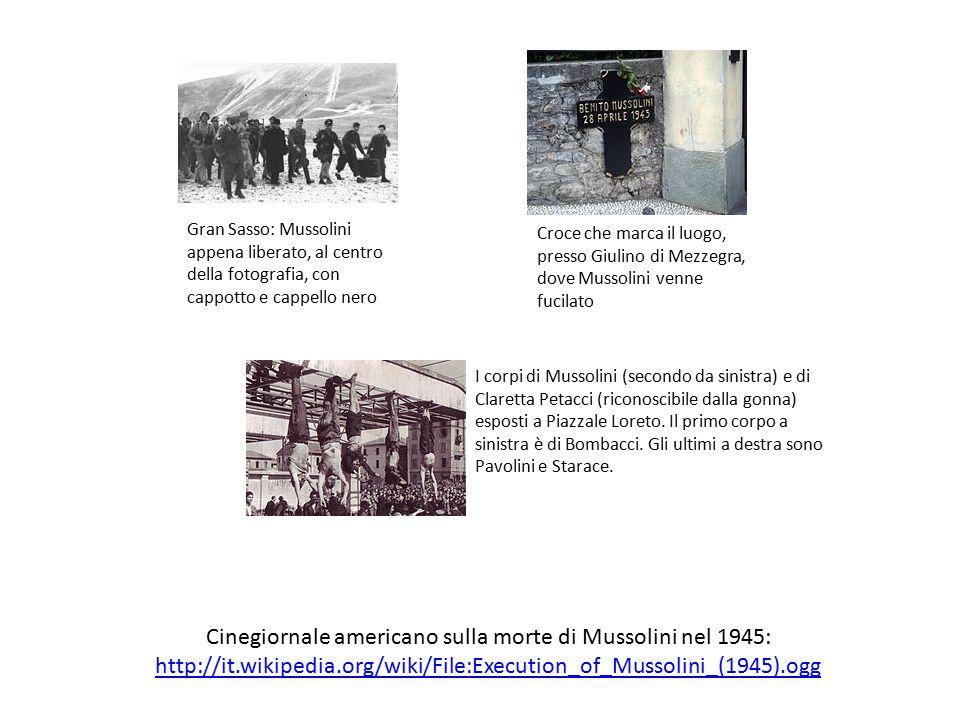 Gran Sasso: Mussolini appena liberato, al centro della fotografia, con cappotto e cappello nero