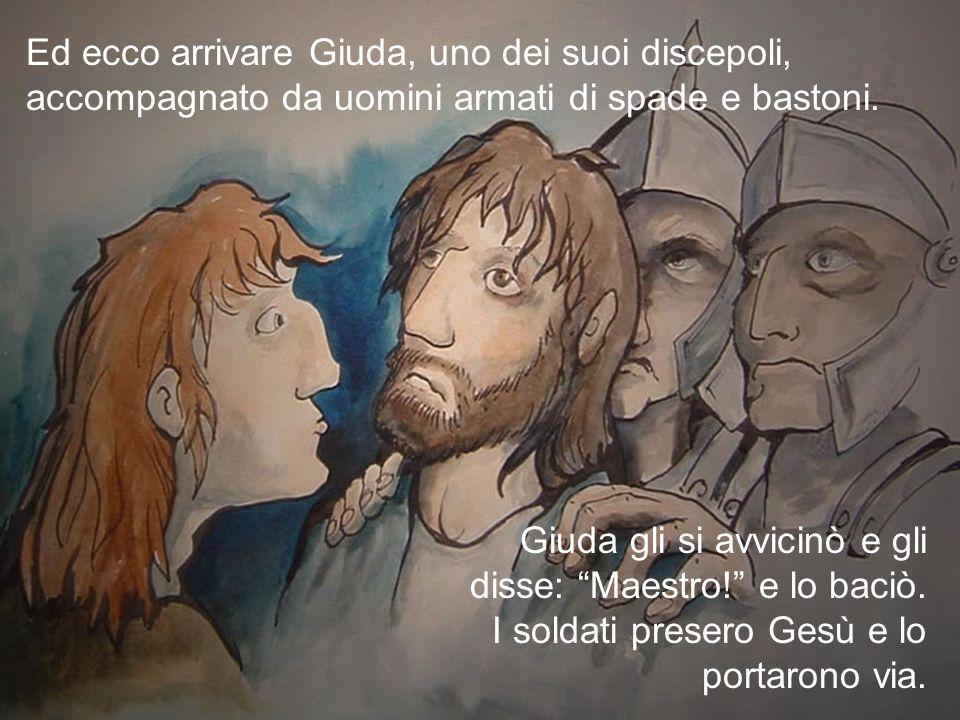 Ed ecco arrivare Giuda, uno dei suoi discepoli, accompagnato da uomini armati di spade e bastoni.