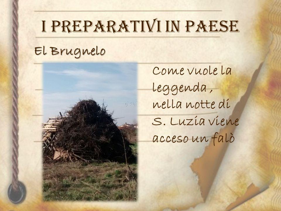 I PREPARATIVI IN PAESE El Brugnelo Come vuole la leggenda ,