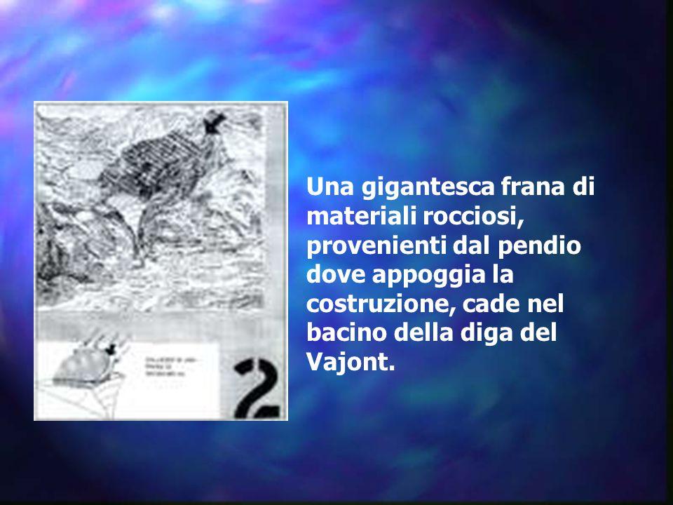 Una gigantesca frana di materiali rocciosi, provenienti dal pendio dove appoggia la costruzione, cade nel bacino della diga del Vajont.
