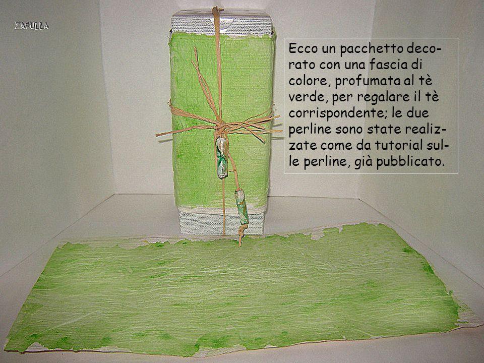 Ecco un pacchetto deco-rato con una fascia di colore, profumata al tè verde, per regalare il tè corrispondente; le due perline sono state realiz-zate come da tutorial sul-le perline, già pubblicato.