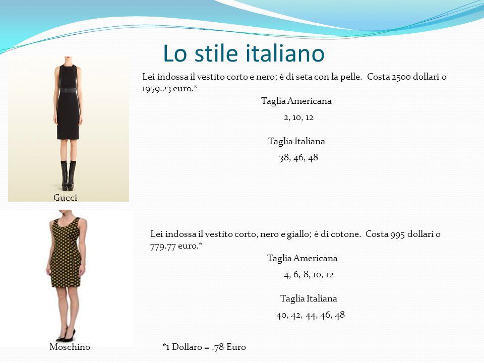 Lo stile italiano Lei indossa il vestito corto e nero; è di seta con la pelle. Costa 2500 dollari o 1959.23 euro.*