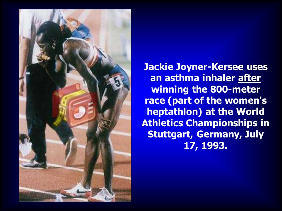 Jackie Joyner-Kersee uses an asthma inhaler after winning the 800-meter race (part of the women s heptathlon) at the World Athletics Championships in Stuttgart, Germany, July 17, 1993.