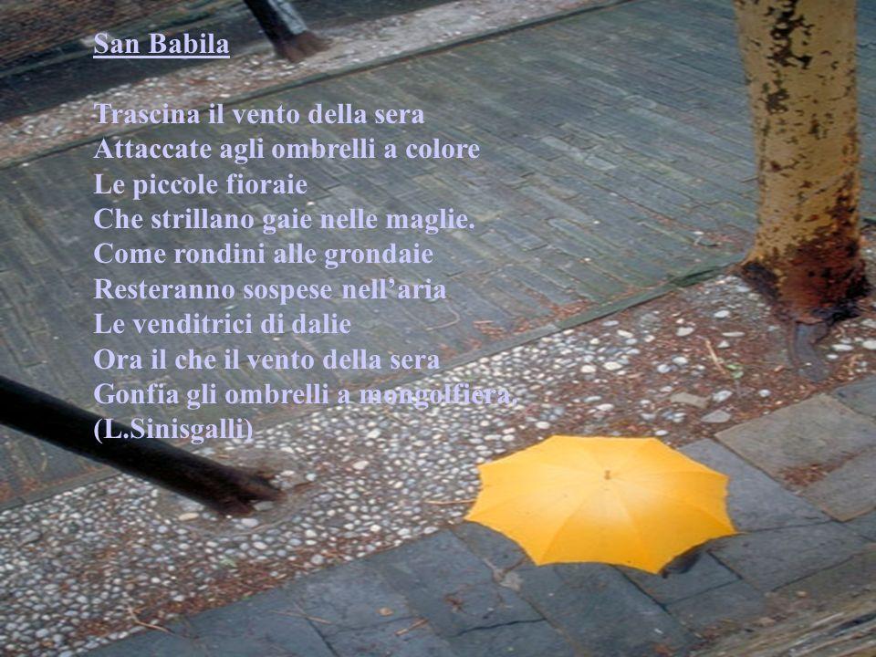 San Babila Trascina il vento della sera. Attaccate agli ombrelli a colore. Le piccole fioraie.
