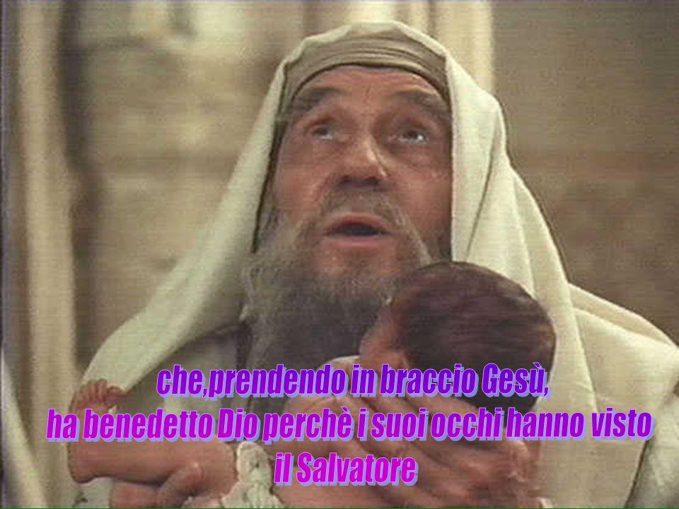 che,prendendo in braccio Gesù,