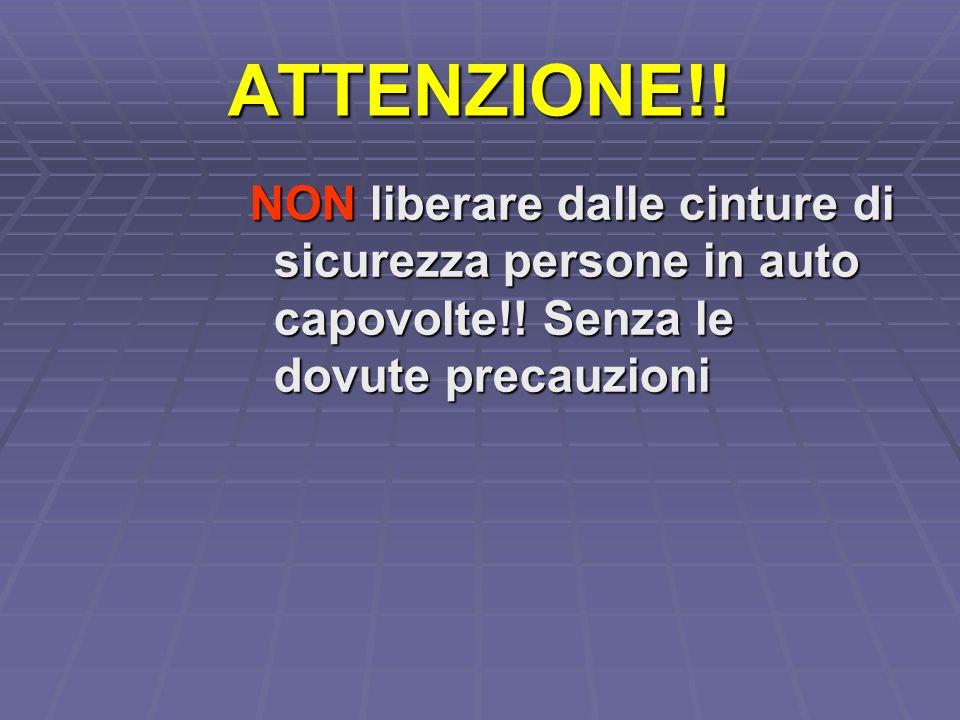 ATTENZIONE!. NON liberare dalle cinture di sicurezza persone in auto capovolte!.