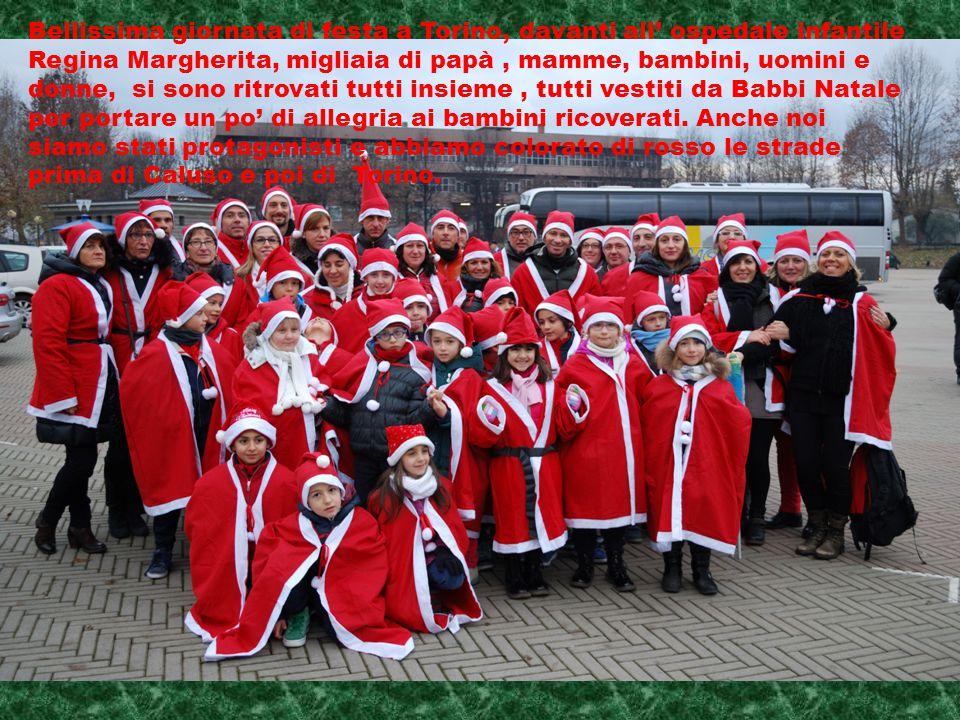 Bellissima giornata di festa a Torino, davanti all' ospedale infantile Regina Margherita, migliaia di papà , mamme, bambini, uomini e donne, si sono ritrovati tutti insieme , tutti vestiti da Babbi Natale per portare un po' di allegria ai bambini ricoverati.