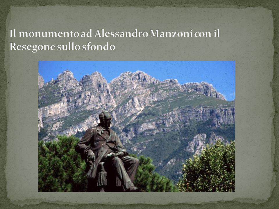 Il monumento ad Alessandro Manzoni con il Resegone sullo sfondo