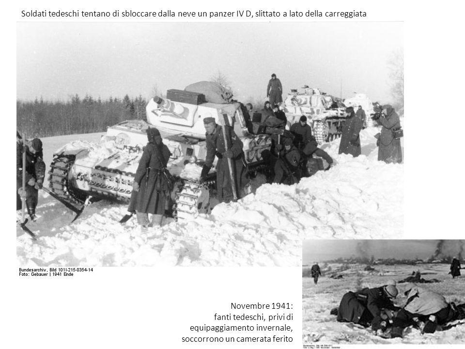 Soldati tedeschi tentano di sbloccare dalla neve un panzer IV D, slittato a lato della carreggiata