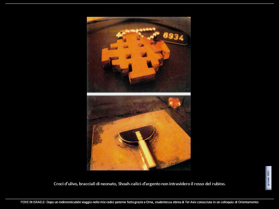 gennaio 2001 Croci d'ulivo, bracciali di neonato, Shoah-calici-d'argento non intravidero il rosso del rubino.