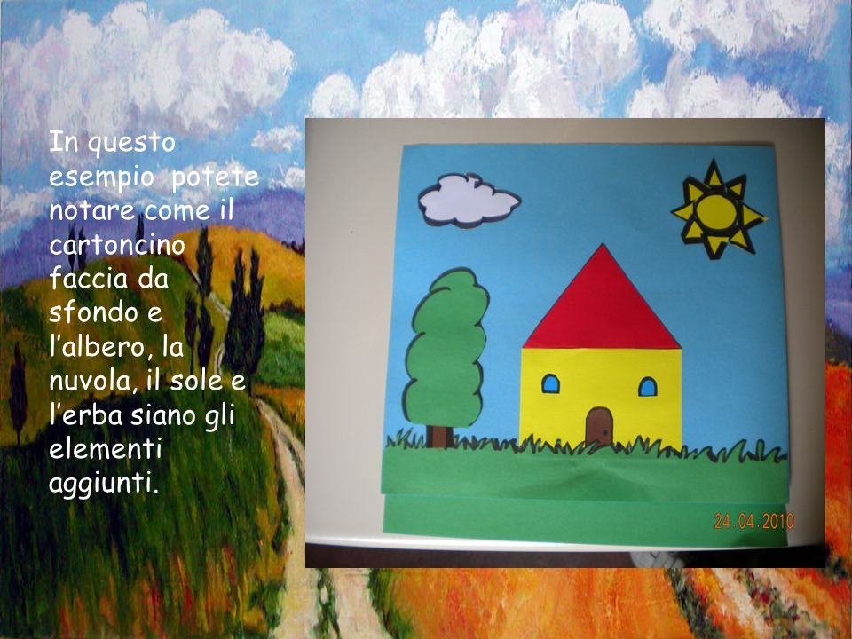 In questo esempio potete notare come il cartoncino faccia da sfondo e l'albero, la nuvola, il sole e l'erba siano gli elementi aggiunti.
