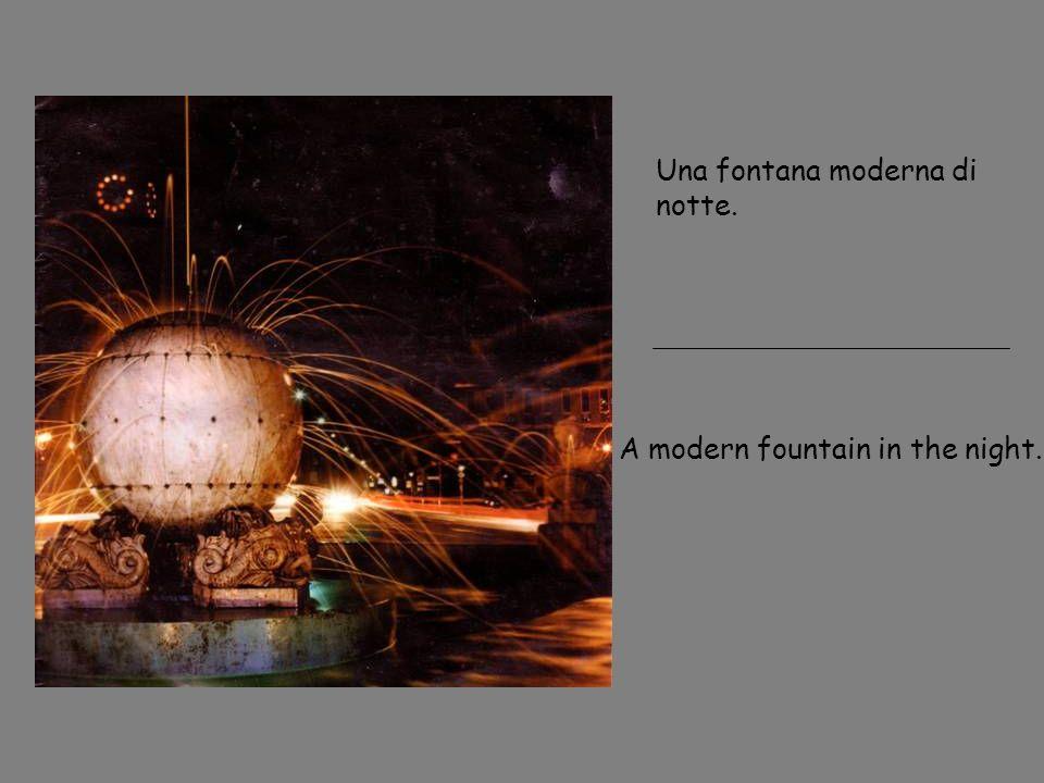 Una fontana moderna di notte.