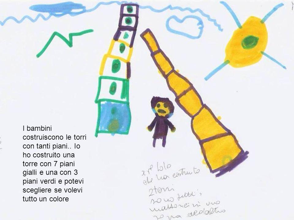 I bambini costruiscono le torri con tanti piani