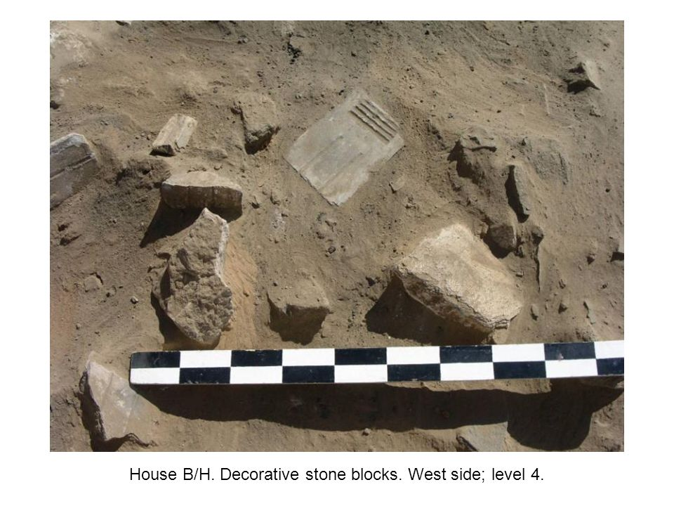 House B/H. Decorative stone blocks. West side; level 4.