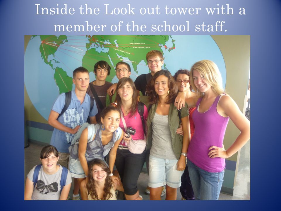 Inside the Look out tower with a member of the school staff.