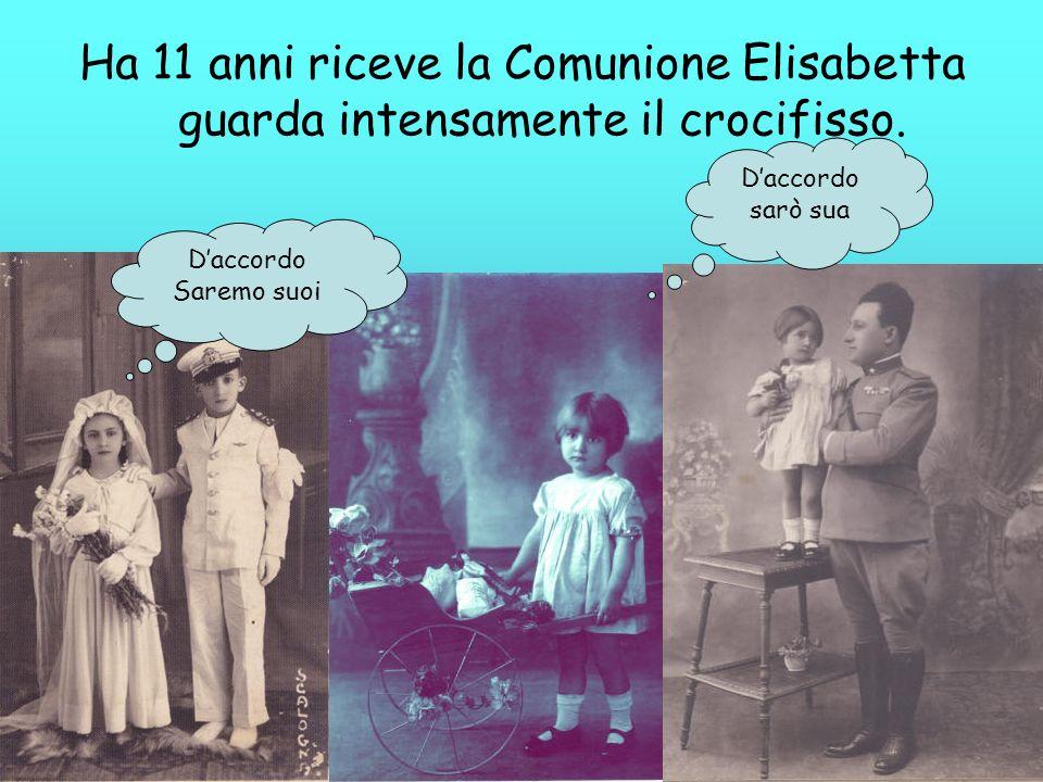 Ha 11 anni riceve la Comunione Elisabetta guarda intensamente il crocifisso.