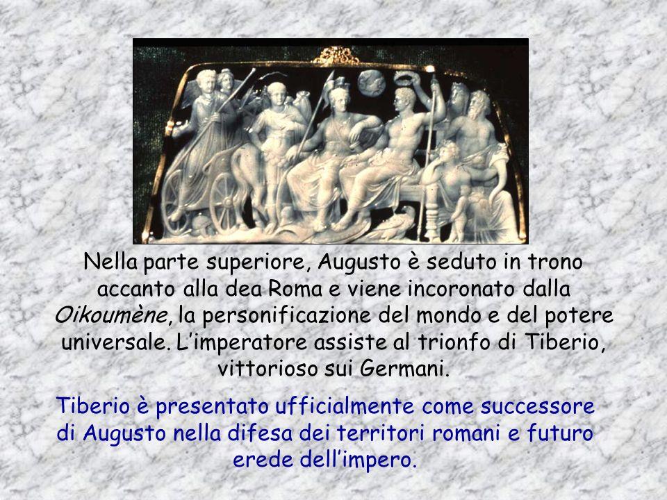 Nella parte superiore, Augusto è seduto in trono accanto alla dea Roma e viene incoronato dalla Oikoumène, la personificazione del mondo e del potere universale. L'imperatore assiste al trionfo di Tiberio, vittorioso sui Germani.