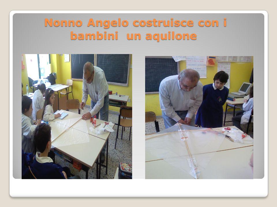 Nonno Angelo costruisce con i bambini un aquilone