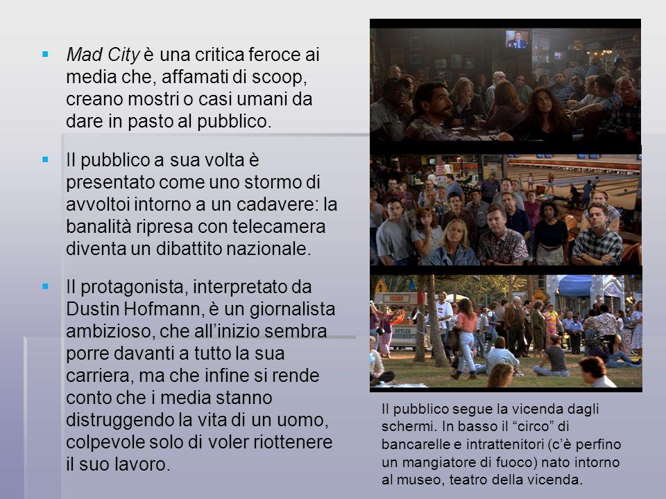 Mad City è una critica feroce ai media che, affamati di scoop, creano mostri o casi umani da dare in pasto al pubblico.