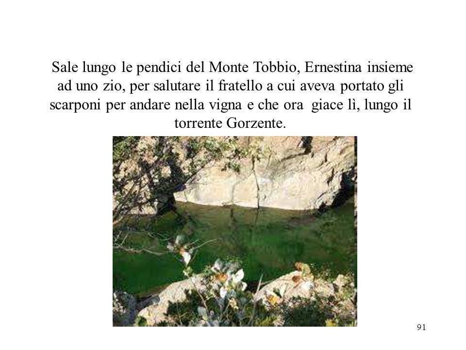 Sale lungo le pendici del Monte Tobbio, Ernestina insieme ad uno zio, per salutare il fratello a cui aveva portato gli scarponi per andare nella vigna e che ora giace lì, lungo il torrente Gorzente.