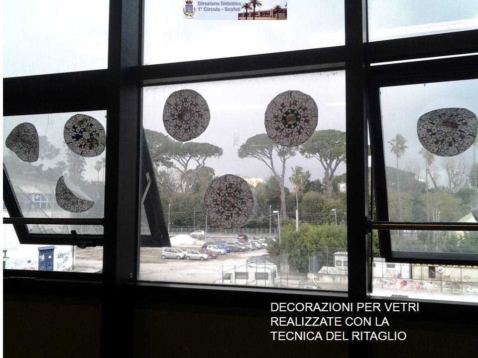 DECORAZIONI PER VETRI REALIZZATE CON LA TECNICA DEL RITAGLIO