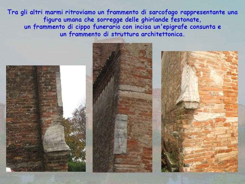 un frammento di cippo funerario con incisa un epigrafe consunta e