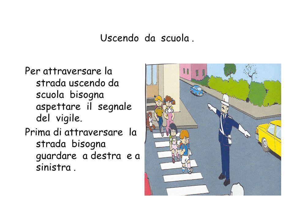 Uscendo da scuola . Per attraversare la strada uscendo da scuola bisogna aspettare il segnale del vigile.