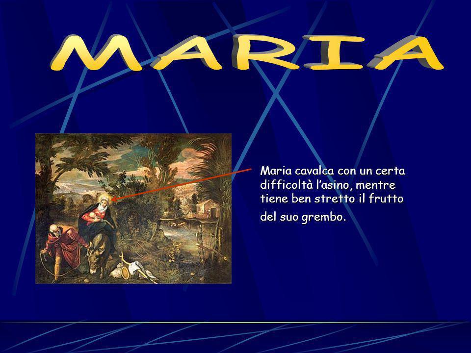 MARIA Maria cavalca con un certa difficoltà l'asino, mentre tiene ben stretto il frutto del suo grembo.