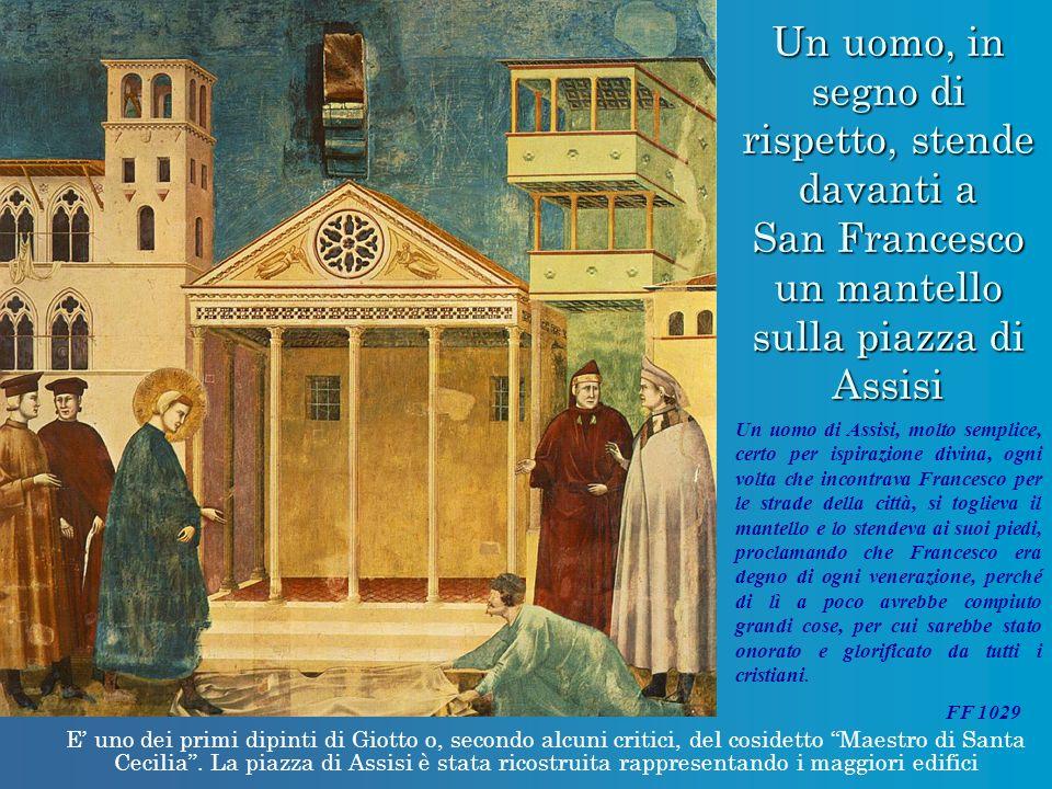 Un uomo, in segno di rispetto, stende davanti a San Francesco un mantello sulla piazza di Assisi