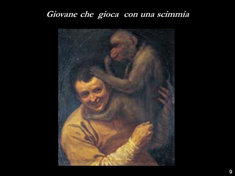 Giovane che gioca con una scimmia