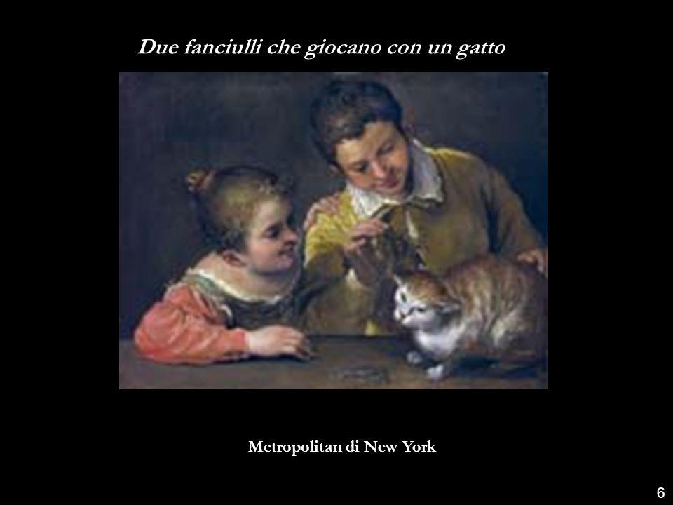 Due fanciulli che giocano con un gatto