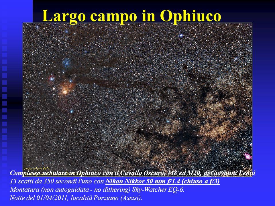 Largo campo in Ophiuco Complesso nebulare in Ophiuco con il Cavallo Oscuro, M8 ed M20, di Giovanni Leoni.