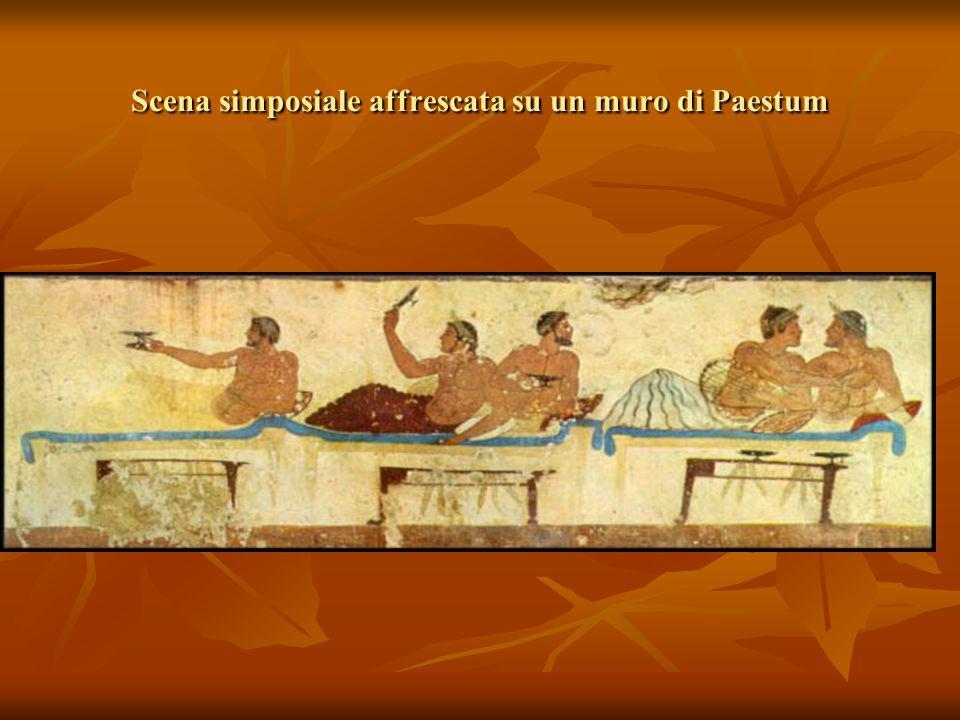 Scena simposiale affrescata su un muro di Paestum