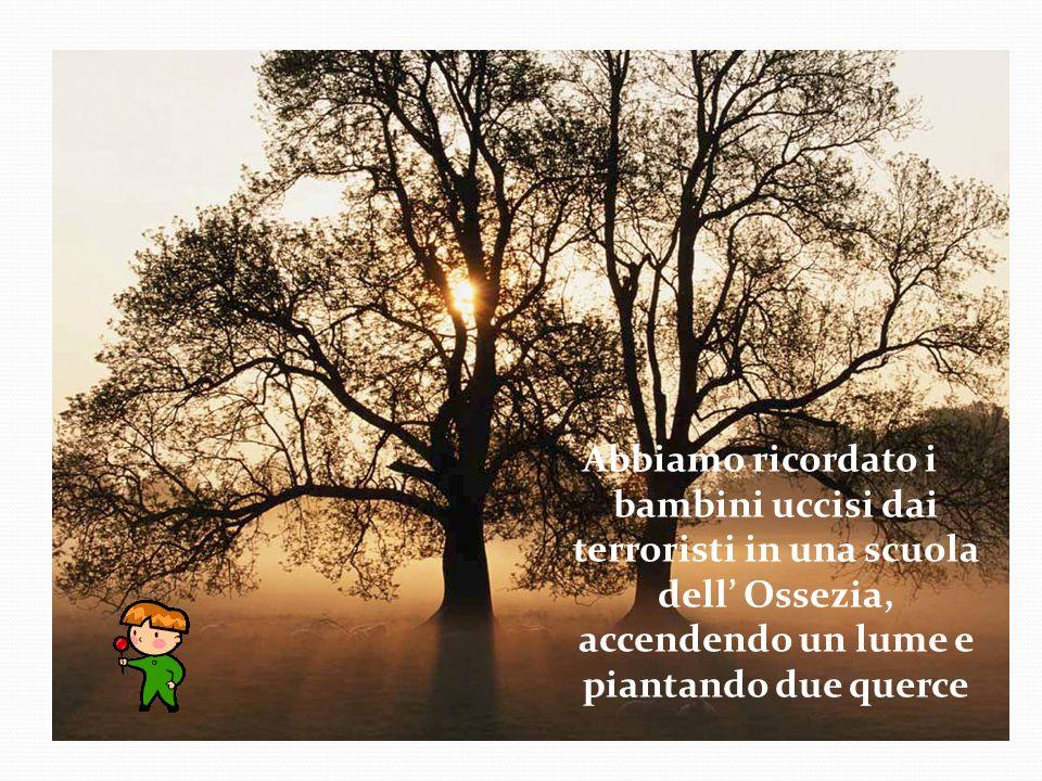 Abbiamo ricordato i bambini uccisi dai terroristi in una scuola dell' Ossezia, accendendo un lume e piantando due querce