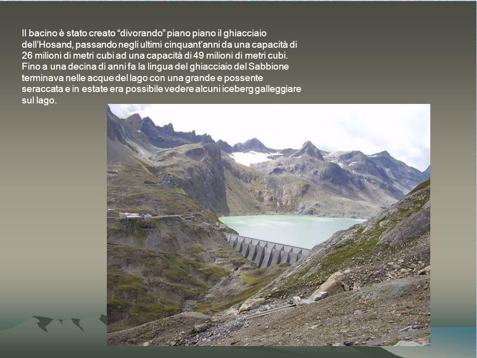 Il bacino è stato creato divorando piano piano il ghiacciaio dell'Hosand, passando negli ultimi cinquant'anni da una capacità di 26 milioni di metri cubi ad una capacità di 49 milioni di metri cubi.
