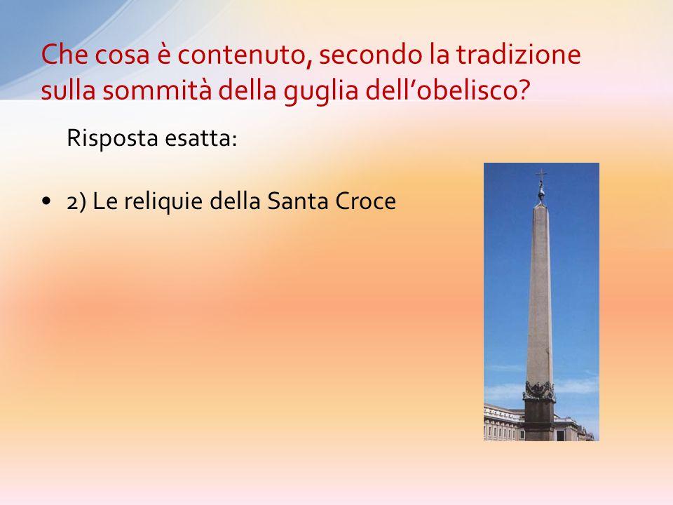 Che cosa è contenuto, secondo la tradizione sulla sommità della guglia dell'obelisco