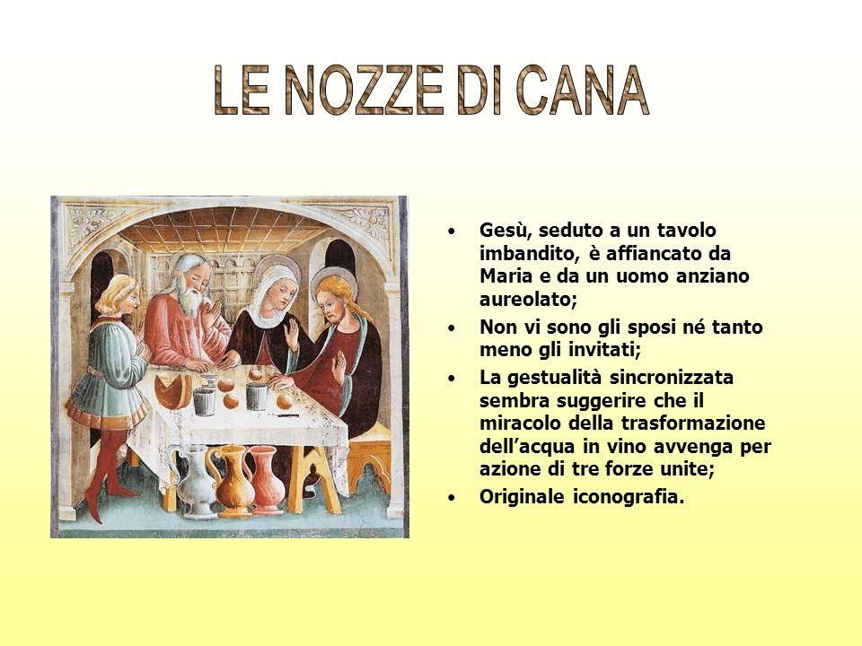 LE NOZZE DI CANAGesù, seduto a un tavolo imbandito, è affiancato da Maria e da un uomo anziano aureolato;