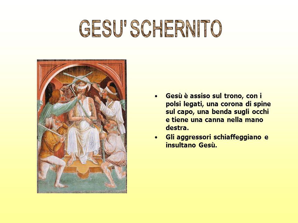 GESU SCHERNITO Gesù è assiso sul trono, con i polsi legati, una corona di spine sul capo, una benda sugli occhi e tiene una canna nella mano destra.