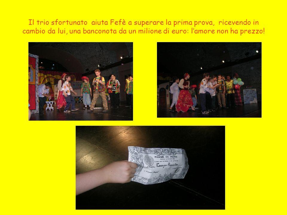 Il trio sfortunato aiuta Fefè a superare la prima prova, ricevendo in cambio da lui, una banconota da un milione di euro: l'amore non ha prezzo!