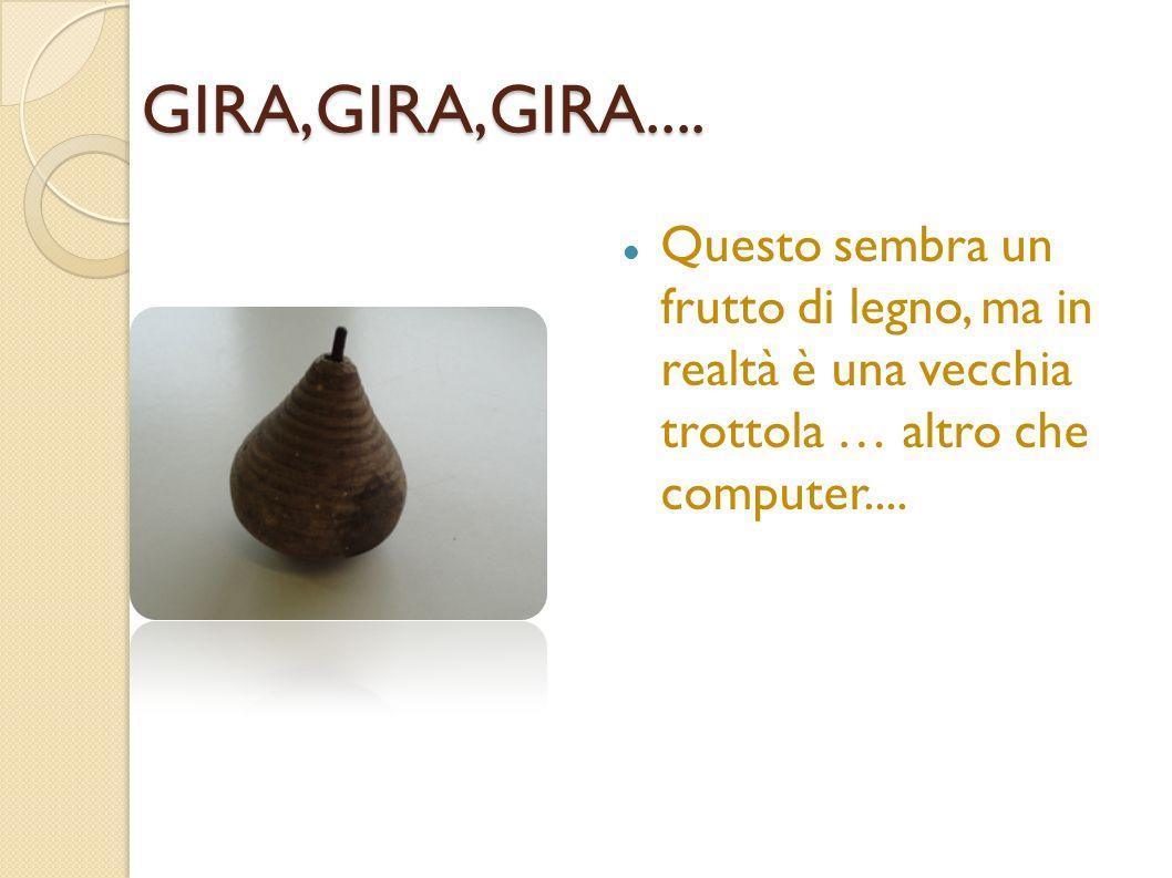 GIRA,GIRA,GIRA....Questo sembra un frutto di legno, ma in realtà è una vecchia trottola … altro che computer....