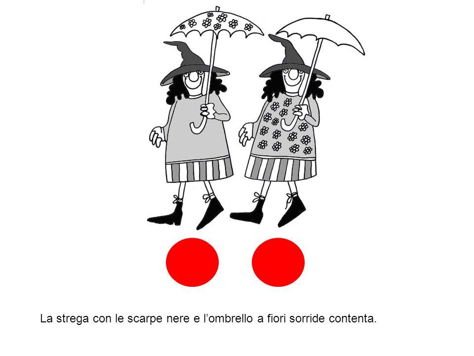 La strega con le scarpe nere e l'ombrello a fiori sorride contenta.